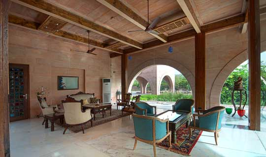 Formal Living with exposed I Girders and bare stone ceiling
